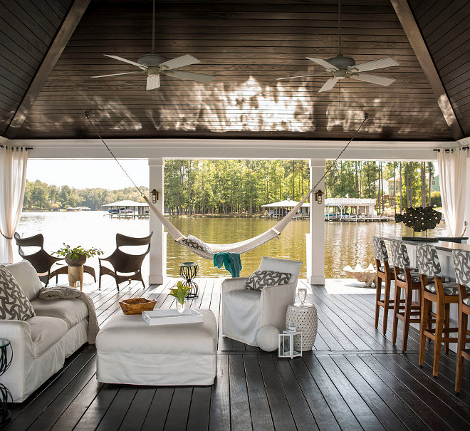 Covered Dock. Party dock. Spacious covered dock, pavilion style dock with outdoor kitchen and outdoor living area. #Dock #CoveredDock #pavilion #partydock Heather Garrett Design