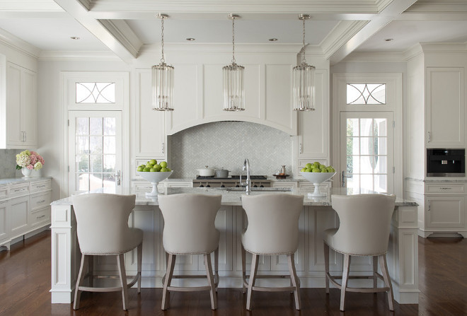 Cream white kitchen. Gorgeous cream white kitchen with coffered ceiling, dark hardwood floor and large cream white kitchen island. #creamwhitekitchen #kitchen #creamwhite #kitchen Pecora Brothers, Inc.
