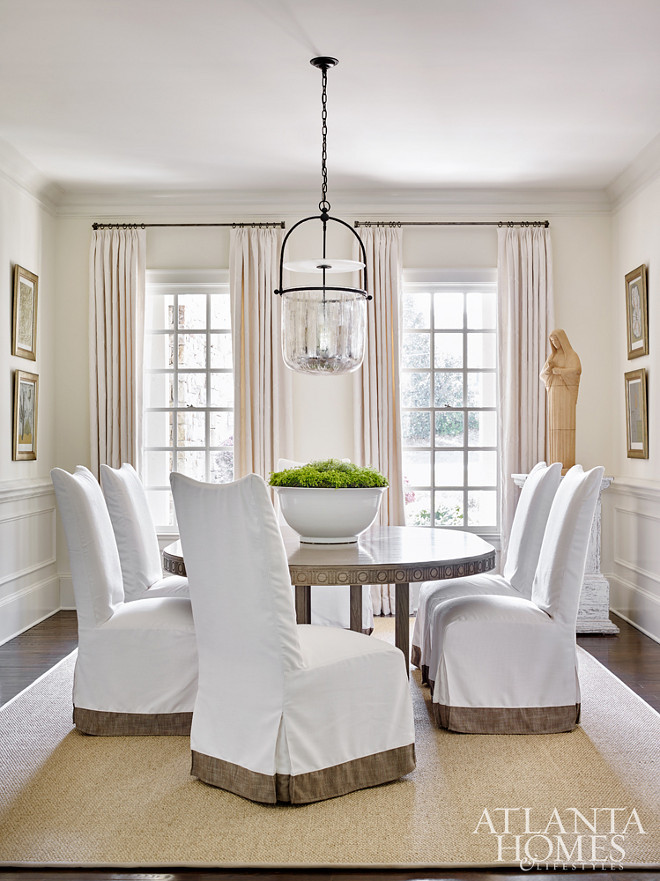 Dining Room. Custom slipcovered chairs and an expanding dining table from Bungalow Classic lend themselves to gatherings during holidays or special occasions #Diningroom Beth Webb Via Atlanta Homes magazine