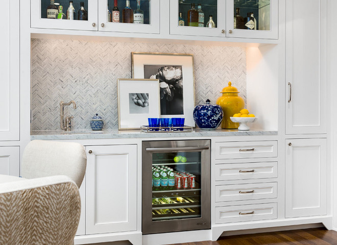 Dining room wet bar. Dining room wet bar cabinet. Dining room wet bar with herringbone backplash tile. #Diningroom #wetbar Robert Frank Interiors. Clark Dugger Photography