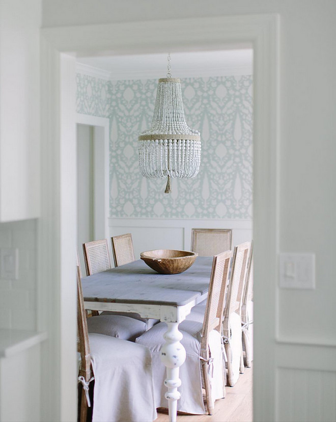 Coastal Farmhouse Dining Room. Coastal Farmhouse Dining Room. Coastal Farmhouse Dining Room with wallpaper and white beaded chandelier. #CoastalFarmhouse #DiningRoom farmhouse-dining-room-kate-marker-interiors