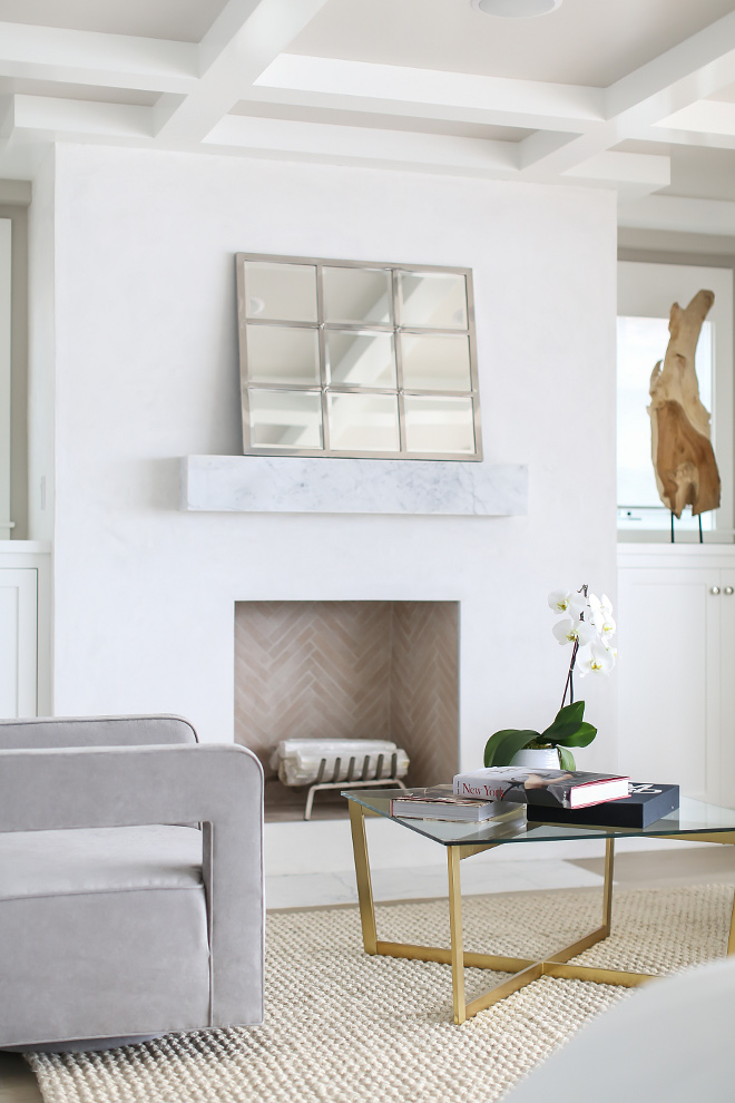 Fireplace Marble mantle. Fireplace features a Floating marble box mantle. The master bedroom fireplace features a floating marble box mantle. #fireplace #mantle #floatingmantle #floatingmarblemantle #floatingmarbleboxmantle Winkle Custom Homes. Melissa Morgan Design. Ryan Garvin Photography