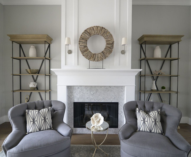 Grey wall paint color with white trim. Wall paint color is Behr Dolphin Fin. Fireplace and trim paint color is Benjamin Moore Simply White OC-117. #Greywall #paintcolor #whitetrim #paintcolors #colorpalette #BenjaminMooreSimplyWhite #BehrDolphinFin  Eye for the Pretty