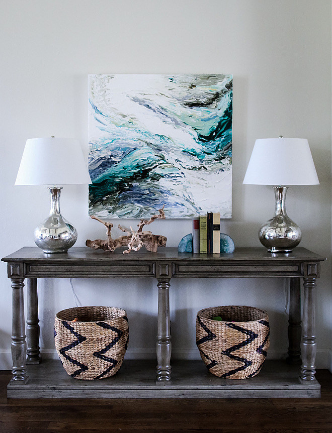 Console table. Baskets under console table are Nate Berkus for Target. Lamps: Ballard Designs. #ConsoleTable #lamps #baskets #art #decor foyer-console-table-decor Home Bunch's Beautiful Homes of Instagram curlsandcashmere