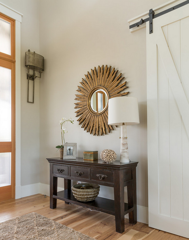 Foyer with Barn Door. This farmhouse style foyer features wide plank floors and a white barn door. Paint color is Sherwin Williams SW7029 Agreeable Gray. Barn Door Foyer. Foyer with Barn Door. Barn Door Foyer Ideas. #FoyerBarnDoor #BarnDoor #Foyer foyer-with-barn-door-barn-door-foyer Restyle Design, LLC.