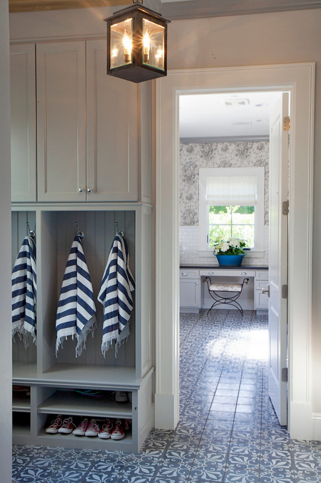 Grey mudroom with patterned floor tile opens to laundry room. #Greymudroom #patternedfloortile #laundryroom gray-mudroom-opens-to-laundry-room-with-patterned-floor-tiles Nicole Lee Interior Designs