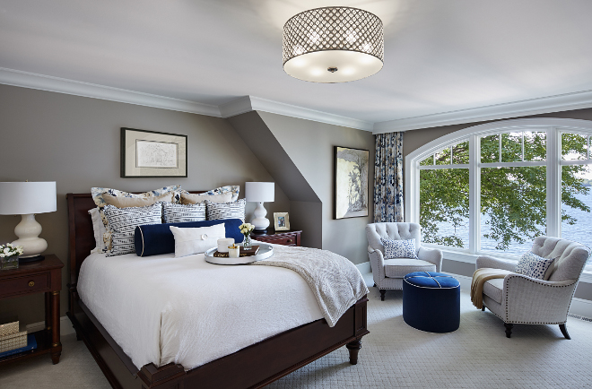 Grey master bedroom. Imagining waking up with a view like that every day. The ottoman, bedding and window treatments are all custom. Lamps are Barbara Cosgrove and the chairs are Lexington. Lighting is Quoizel. #bedroom #greybedroom Vivid Interior Design. Hendel Homesgrey-master-bedroom