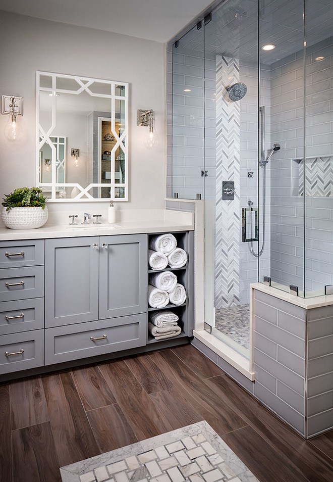 Grey bathroom tiling. Grey tiles. Heringbone accent tile is Arizona Tile Grey Polished Mesh. Grey subway tile is a 4x16 Arizona Tile H-Line. Grey bathroom tiling ideas. Grey bathroom tiling. #Greytiling #bathroomtiling grey-bathroom-tiling Tracy Lynn Studio
