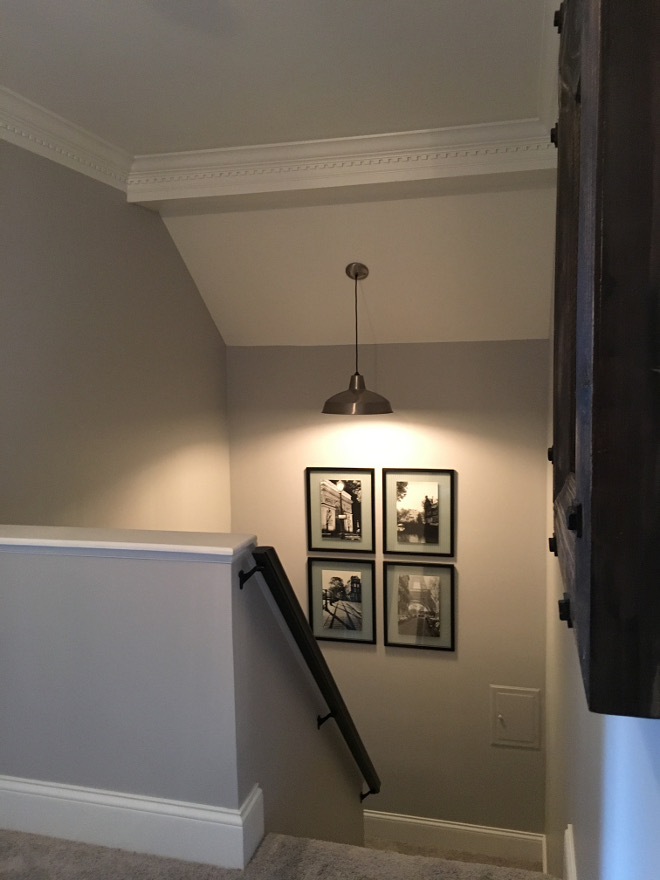 Grey paint color with white trim. Grey wall paint color is Metro Gray Benjamin Moore. White Trim paint color isWhite in Satin Finish By Benjamin Moore