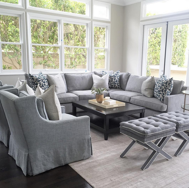 Grey sofa sectional with grey chairs and grey benches. Living room with Grey sofa sectional with grey chairs and grey benches. #livingroom #Greysofa #Greysectional #greychairs #greybenches Brooke Wagner Design