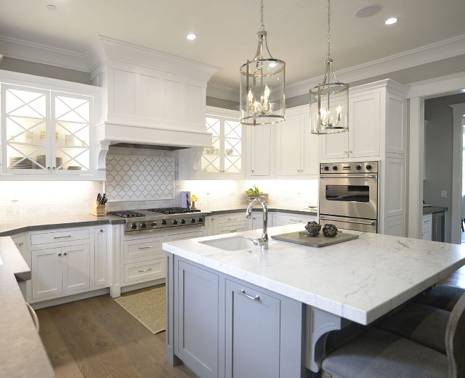 Kitchen. This kitchen is truly impressive! I love the crisp white cabinets with the grey walls and grey kitchen island. Wall paint color is Behr Dolphin Fin. Lights are Lara Pendant via Joss and Main Polished Nickel.  #whitekitchen #kitchen #whitekitchens #Behrdolphinfin Eye for the Pretty