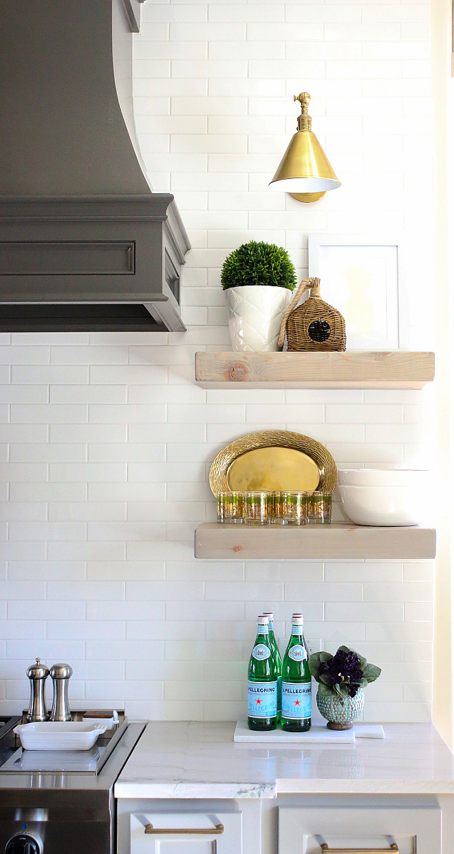 Kitchen Floating Shelves. Open shelving by kitchen hood are reclaimed floating shelves from Renaissance Wood in OKC, OK. kitchen-small-shelves Kitchen Floating Shelves #Kitchen #FloatingShelves #reclaimedshelves #reclaimedopenshelves Home Bunch's Beautiful Homes of Instagram curlsandcashmere