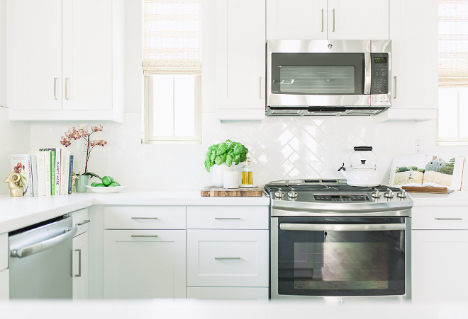 Backsplash is white herringbone subway tile with white grout. Appliances are by GE. kitchen-appliances-affordable-kitchen-appliances-kitchen-appliances-are-by-ge-kitchenappliances-appliances-affordablekitchenappliances