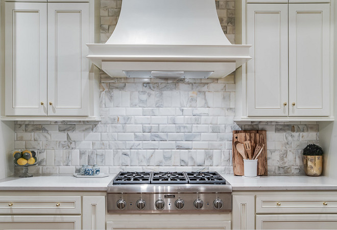 Kitchen backsplash. The backsplash is Calacatta gold beveled edge subway tile. Notice how teh tile is set. #backsplash #tile #Calacattagold #bevelededge #subwaytile kitchen-backsplash Ivy House Interiors