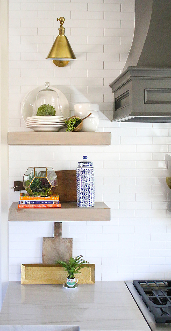Library Sconces Above Shelving: Visual Comfort Boston Library light in Antiqued brass. kitchen-floating-shelves Home Bunch's Beautiful Homes of Instagram curlsandcashmere