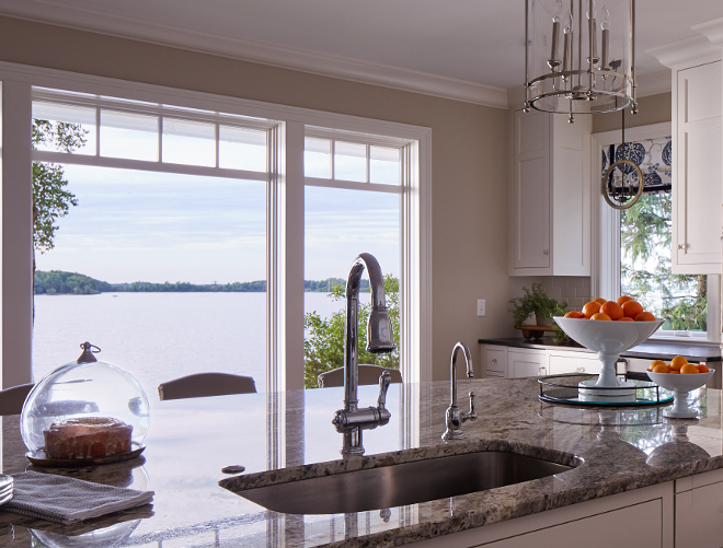 Kitchen island. The kitchen island features a white and gray granite countertop; Serenity Granite. Kitchen faucet is Victorian Pull-Down Kitchen Faucet by DXV. Sink is by Blanco. #kitchenisland #faucet #countertop #sinkkitchen-faucet Vivid Interior Design. Hendel Homes