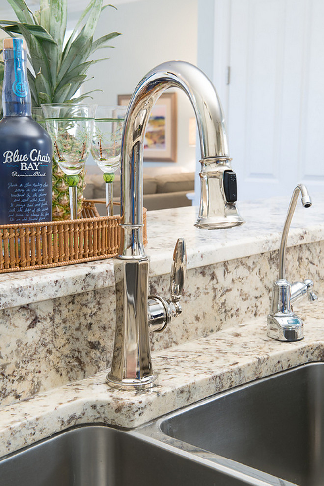 Granite countertop and polished nickel kitchen faucet. kitchen-faucet-karr-bick-kitchen-and-bath