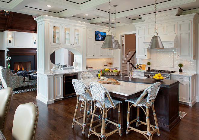 Kitchen. The kitchen is one of my favorite rooms of the house. The layout is perfect for cooking and family living. Notice the island with its own bistro-style table area. Ceiling is painted in Benjamin Moore Icicle 2142-70 and features Poplar wood trim in custom stain. The kitchen island is Walnut in custom stain. #kitchen #kitchens #kitchen #kitchens Vivid Interior Design. Hendel Homes