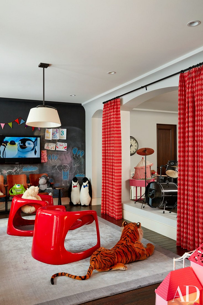 Kourtney Kardashian Home Pictures. Khloé and Kourtney Kardashian Home Kids Playroom. In the playroom, Italian lounge chairs from JF Chen rest on an RH rug; the television is by Samsung, and the chalkboard paint is by Benjamin Moore. #Kourtney Kardashian Home Pictures. #KhloéKardashianHome #KourtneyKardashianHome #Kids #Playroom Via Architectural Digest