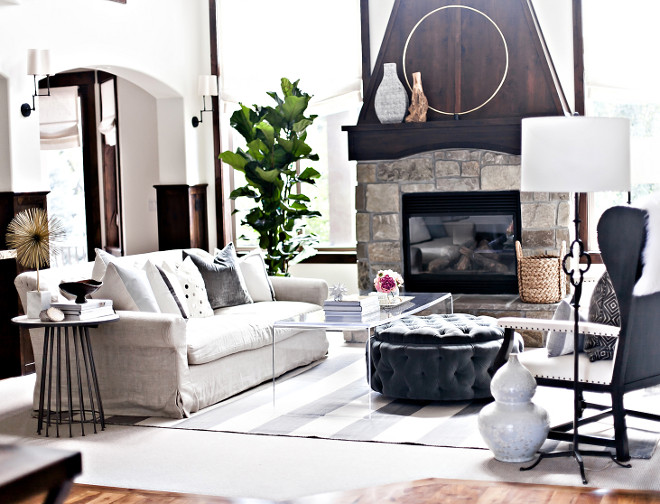 Living room wood and stone fireplace. Wood and stone fireplace. Living room wood and stone fireplace ideas #Livingroom #woodfireplace #stonefireplace LIV Design Collective