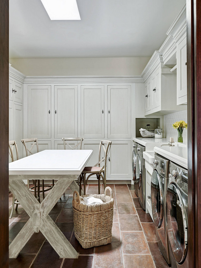 laundry-room-laundry-room-features-custom-x-leg-table-for-folding-custom-cabinets-farmhouse-sink-and-2-washers-2-dryers The Refined Group.