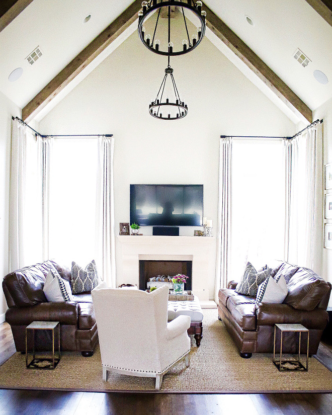 The floor to ceiling windows let in so much light into this room, I just love it. The vaulted ceiling with beams adds just the right amount of interest and elegance to this space. living-room-ceiling Lighting: Hinkley. Home Bunch's Beautiful Homes of Instagram curlsandcashmere