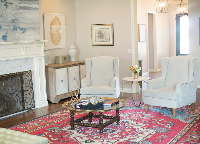 The small accent table between the chairs is from Gabby Home and can be purchased through Ivy House. The foyer can be seen straight ahead behind the chairs. Ivy House Interiors