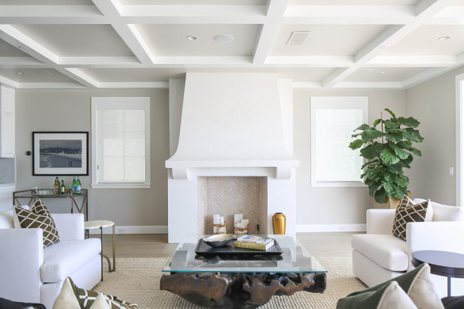 Living room coffered ceiling and white stucco fireplace. Neutral Living room coffered ceiling and white stucco fireplace. More details on the stucco fireplace and on the coffered ceiling on the blog. #Livingroom #cofferedceiling #whitestucco #stuccofireplace Winkle Custom Homes. Melissa Morgan Design. Ryan Garvin Photography