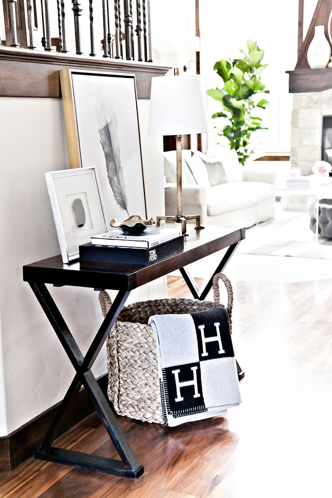 Living room rattan basket for throws. LIV Design Collective