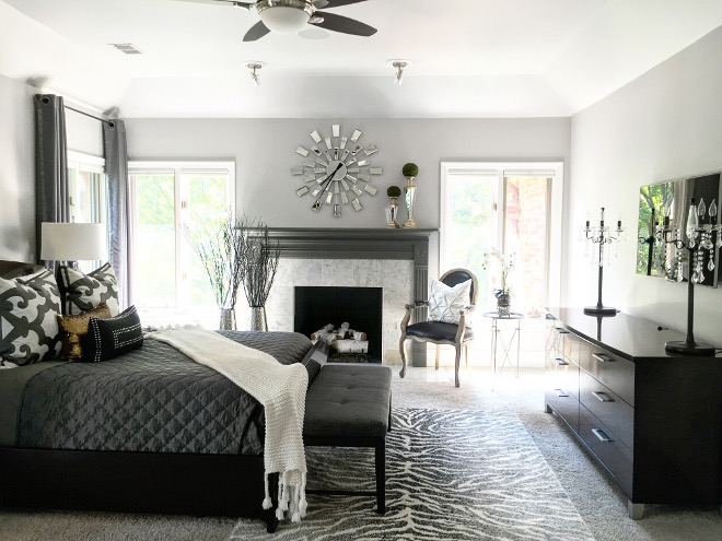 Master Bedroom Fireplace. Benjamin Moore Kendall Charcoal in High Gloss. Fireplace Paint Color: Benjamin Moore Kendall Charcoal in High Gloss Finish and Carrara Marble. #BenjaminMooreKendallCharcoal #highgloss Beautiful Homes of Instagram Sumhouse_Sumwear