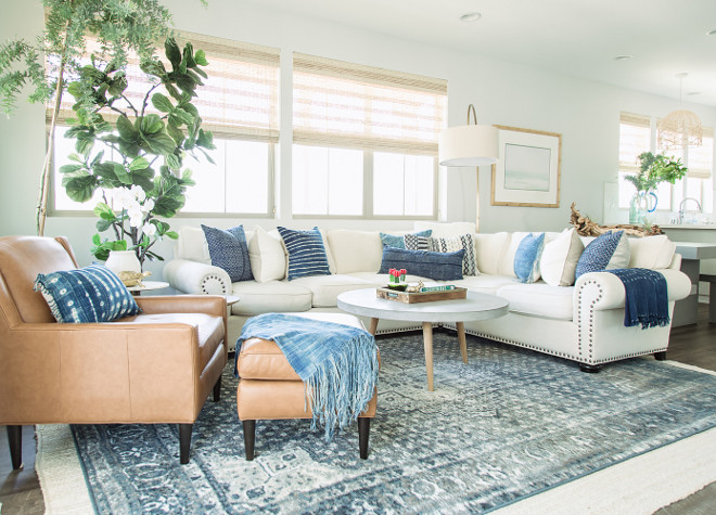 "Living room Design: ""We worked hard to make this space light and fresh. We love all the natural light and complimented it with different shades of grey and blue. The cool colors paired with the cream linen couch look great and we love how the different textures and patterns on the pillows work together. It was so much fun bringing in the concrete accents and we think this modern twist really adds to the room's uniqueness"". modern-living-room-color-palette-small-living-room-with-modern-color-palette-modern-living-room-color-palette-modernlivingroom-livingroomcolorpalette-livingroom-colorpalette"