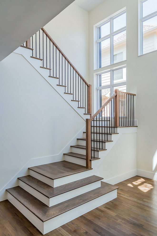 Open entry with white oak hardwood flooring and hardwood stair treads. Hardwood Stair Treads. Open entry with white oak hardwood flooring and hardwood stair treads. White oak hardwood stair treads. #hardwood #stairtreads Tanner Homes & Tiper Residential Development.