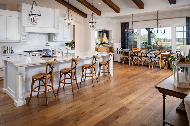 Open kitchen with hardwood flooring. The kitchen hardwood flooring is Carlton Landmark Collection White Oak Sherwood. #kitchen #hardwoodflooring Tracy Lynn Studio