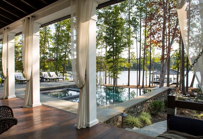 Outdoor draperies. Sheer outdoor draperies. Porch with outdoor draperies. #Outdoor #Draperies #SheerOutdoorDraperies Heather Garrett Design