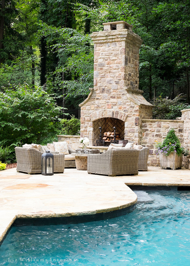 Outdoor pool patio fireplace. Outdoor fireplace placed on pool patio. Pool patio fireplace. Enchanting outdoor area with pool, patio and outdoor fireplace. #Outdoors #Outdoorfireplace #pool #patio Liz Williams Interiors
