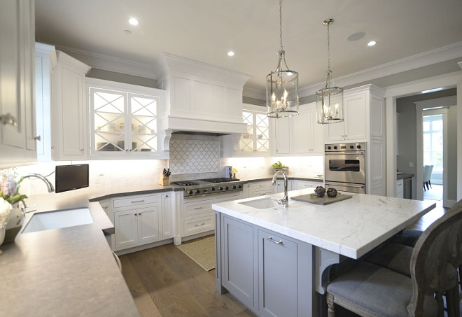 The island countertop is Honed Statuary Marble. Perimeter countertop is Euro Stone K work Grain. Countertops. Kitchen island and kitchen perimeter countertop. #islandcountertop #HonedStatuaryMarble #Perimetercountertop #EuroStoneKworkGrain perimeter-and-island-countertop Eye for the Pretty