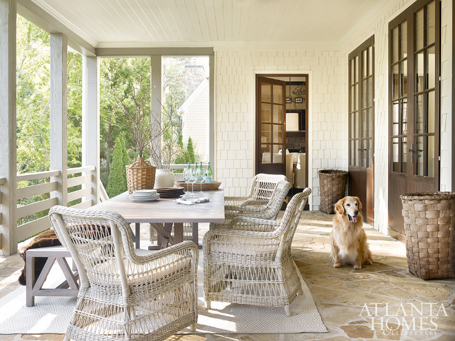 Porch. Back Porch. Elegant as any interior space, the porch is a study in natural materials and organic hues, creating a soft and serene scheme. A long, weathered teak table from Janus et Cie anchors the room. It is surrounded by comfortable woven armchairs by Kingsley-Bate. A teak dining bench, also by Janus et Cie, provides plenty of seating for friends and family. The rug is by Dash & Albert. The wicker demijohn is from A. Tyner Antiques. #BackPorch #porch #Porchtable #porchChairs #Porches #Backporches Beth Webb Via Atlanta Homes