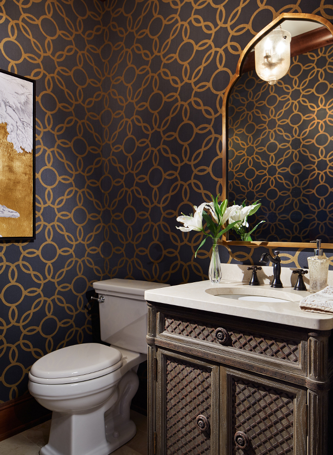 Powder room. The powder room features a gorgeous navy and metallic gold wallpaper by Phillip Jeffries. #powderroom #wallpaper #navywallpaper #metallic powder-room Vivid Interior Design. Hendel Homes