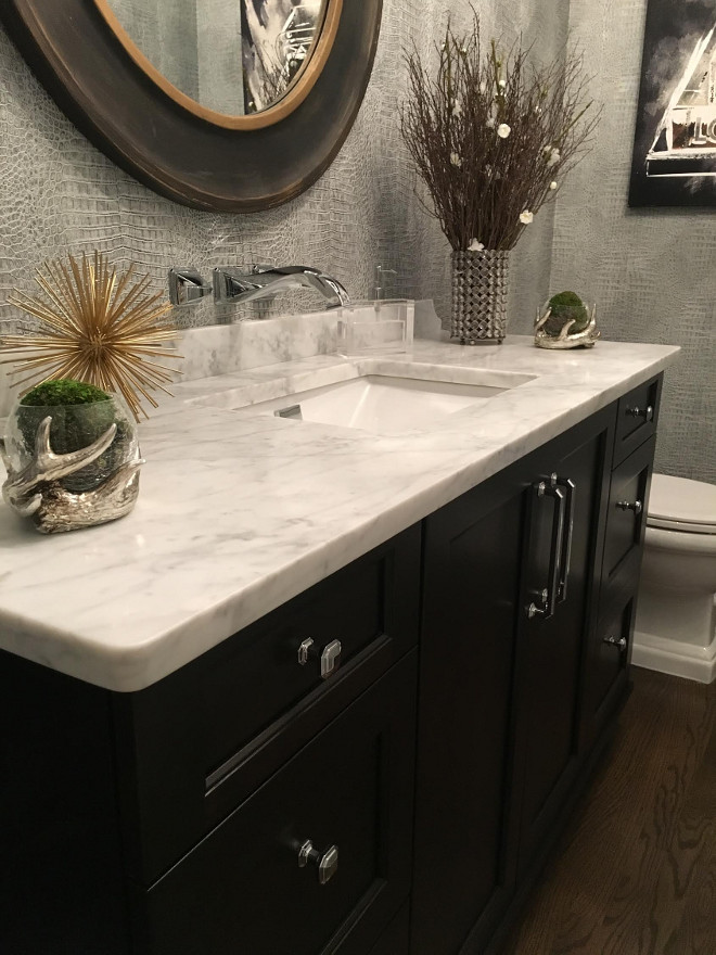 Powder room Dark Cabinet and honed marble countertop. Countertop is Honed Carrara Marble from MS International, Inc. Sink is Toto. . Beautiful Homes of Instagram Sumhouse_Sumwear