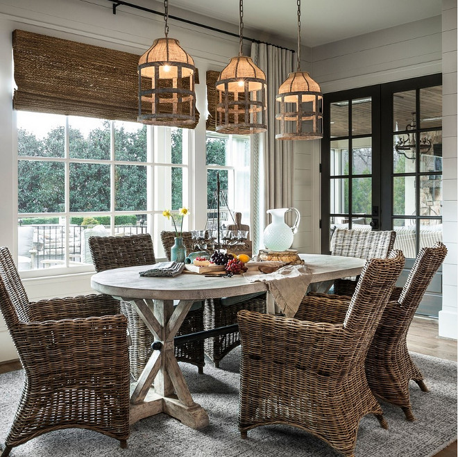 Rattan Dining Chair and woven roman shades. Rustic farmhouse dining room with Rattan Dining Chair and woven roman shades. Rattan Dining Chairs. #Rattan #DiningChair #wovenshades #wovenromanshades