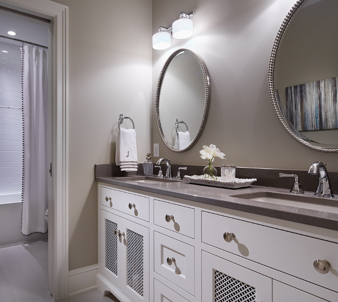 Benjamin Moore HC 172 Revere Pewter Bathroom. Bathroom paint color is Benjamin Moore HC 172 Revere Pewter. Cabinet is BM White Dove. revere-pewter-hc-172-benjamin-moore-bathroom #bathroom #paintcolor #BenjaminMooreHC172ReverePewter Vivid Interior Design. Hendel Homes