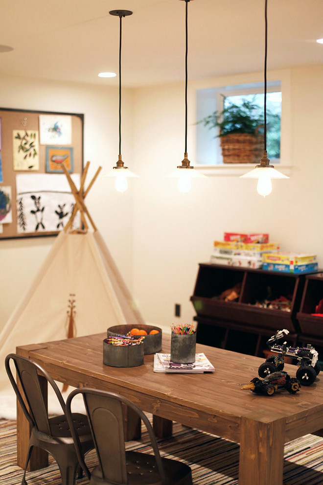 Rustic Industrial Playroom. The table and chairs are part of the Restoration Hardware line for kids. Pendants are Hudson Valley Lighting 3102-OB-008 Vintage Old Bronze Pendant. Rustic Playroom with industrial lighting #RusticPlayroom #industriallighting H2 Design and Build