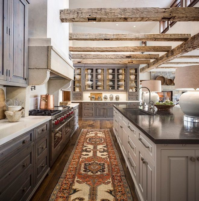 Rustic Kitchen. Rustic kitchen with reclaimed beams, stained rustic cabinets and soft gray island. Rustic kitchen runner. Rustic Kitchen #RusticKitchen #Kitchen Tiffany Farha Design