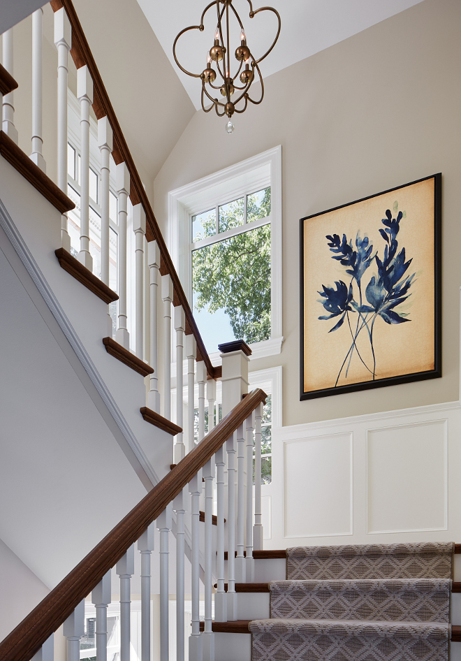 Stair paint color. Stair millwork paint color. Stair paint color is Sherwin Williams SW 7036 Accessible Beige. Wainscotting paint color is Benjamin Moore White Dove. sherwin-williams-sw7036-accessible-beige-wall-paint-color-wainscotting-paint-color-is-benjamin-moore-oc-17-white-dove #Stair #paintcolor #Stairmillworkpaintcolor #Stairpaintcolor #SherwinWilliamsSW7036AccessibleBeige #Wainscotting #BenjaminMooreWhiteDove Vivid Interior Design. Hendel Homes