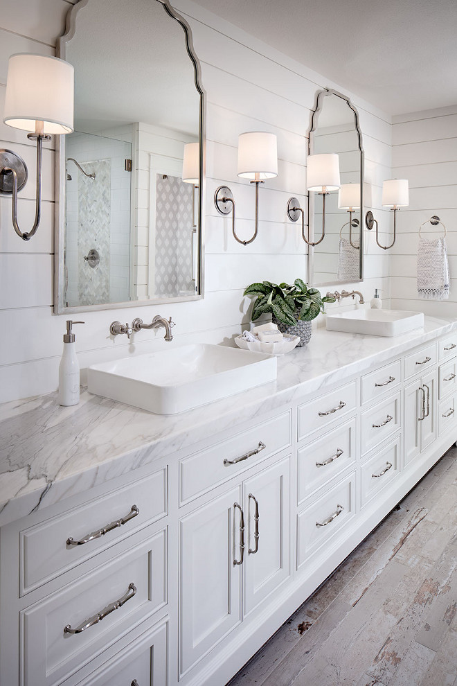 Shiplap bathroom wall with white cabinetry, white marble countertop, wall mount faucet and rustic looking floor tile. #Shiplapbathroom #bathroom #Shiplapwall #whitecabinetry #whitemarblecountertop #wallmountfaucet #rusticlookingfloortile shiplap-bathroom-wall-with-white-cabinetry-and-rustic-looking-floor-tile Tracy Lynn Studio