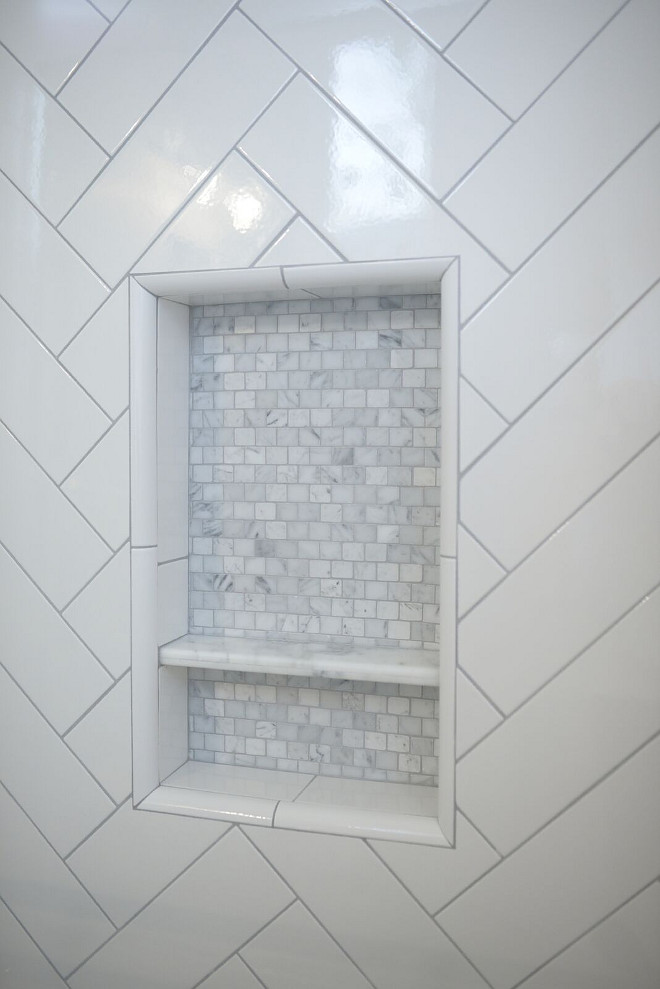 Shower niche. The shower niche features marble mosaic tile. #showerniche #showernichetie shower-niche