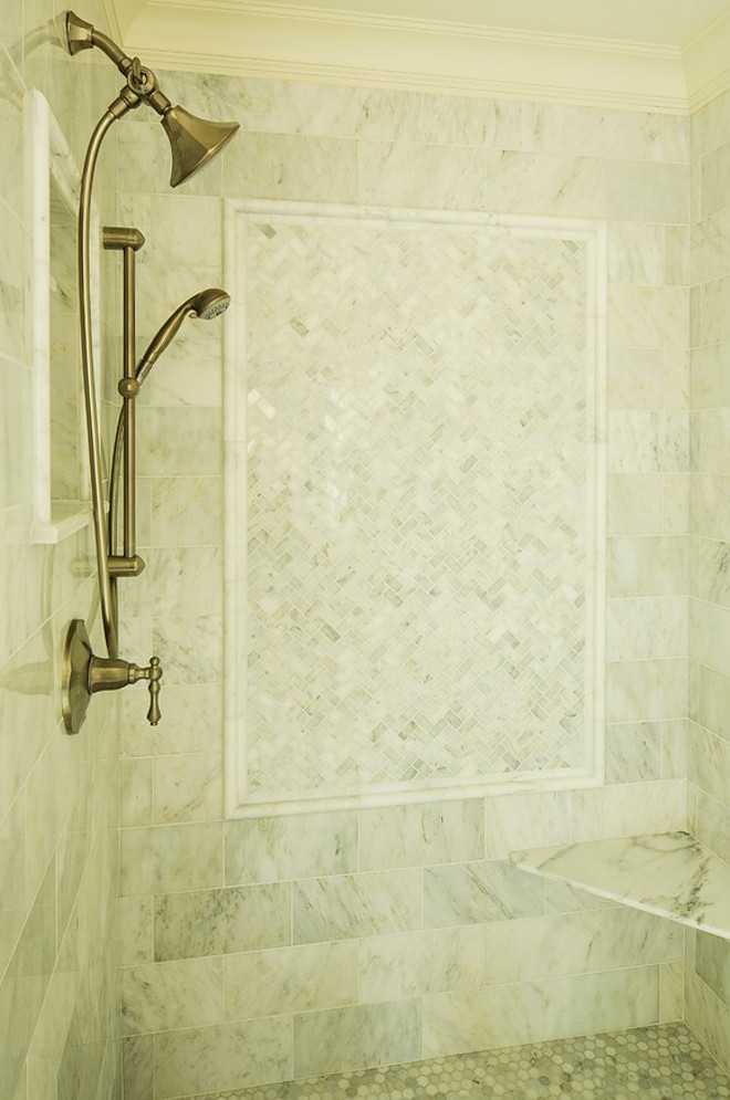 Shower tiling is Carrara Marble cut into different sizes/patterns. Carrara marble shower tile. Shower tiling is Carrara Marble. #Shower #tiling ##Showertiling #CarraraMarble Hendel Homes. shower-tiling