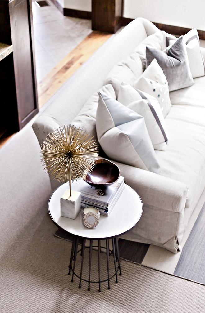 Sofa pillows and side table decor. Neutral Sofa pillows and side table decor. neutral living room Sofa pillows and side table decor #Sofa #pillows #sidetabledecor #livingroom LIV Design Collective