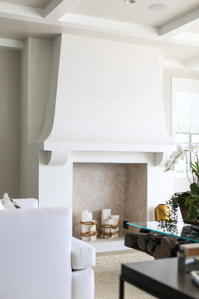 "Stucco Fireplace. Isokern custom masonry fireplaces built on site with herringbone firebrick cut down to 2"" x 8"" . white grout. Fireplace face is white smooth stucco finish to resemble a plaster wall. #fireplace #stucco #Isokern #custom #masonry #fireplaces #builtonsite #herringbone #firebrick Winkle Custom Homes. Melissa Morgan Design. Ryan Garvin Photography"