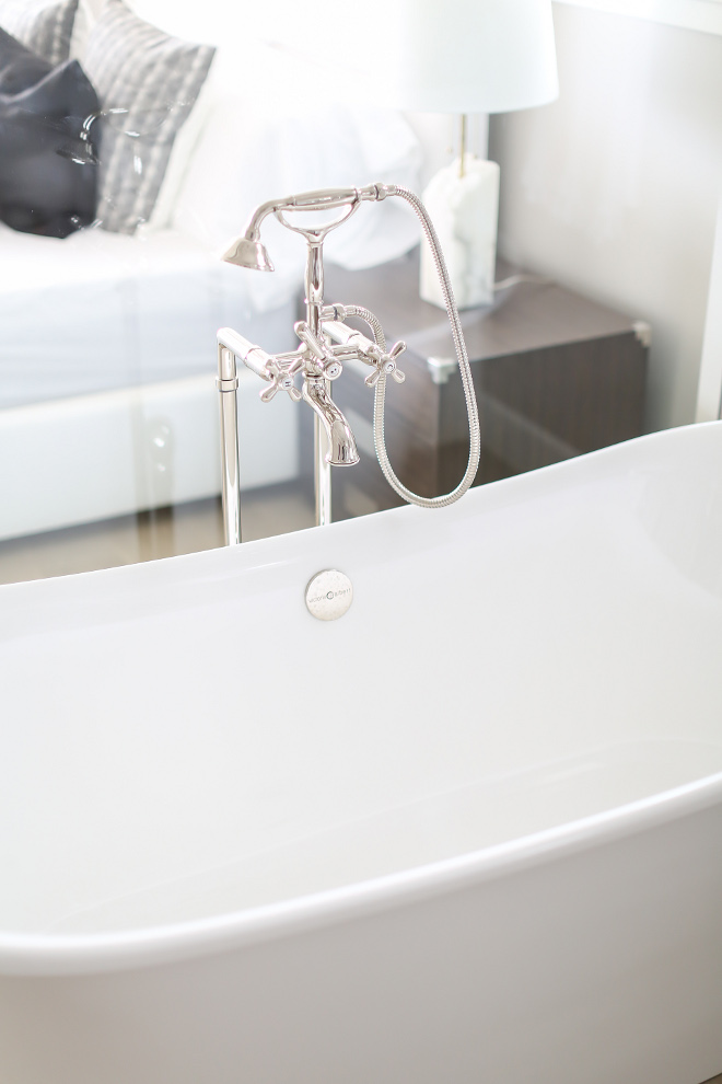 Tub Filler. Master tub is by Victoria + Albert. Tub filler is by Rohl. Winkle Custom Homes. Melissa Morgan Design. Ryan Garvin Photography